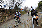 Belgium, March 31 2013: Emma Johanson, ORICA-AIS, leads the riders over the Oude-Kwaremont in the women's Ronde van Vlaandaren 2013 race. Just behind her are Elisa Longo Borghini, HITEC PRODUCTS UCK, and eventual winner Marianne Vos, RABO WOMEN CYCLING TEAM. Copyright 2013 Peter Horrell.