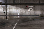 Parking garage sign designating compact car parking only. Missoula Photographer