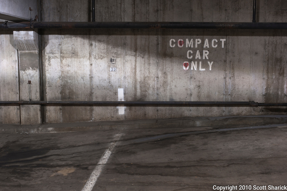 Parking garage sign designating compact car parking only. Missoula Photographer
