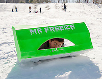 """Alex Richardson takes to the sliding hill in his """"Mr. Freeze"""" sled during Gilford Parks and Recreation Cardboard Derby on Wednesday morning.  (Karen Bobotas/for the Laconia Daily Sun)"""