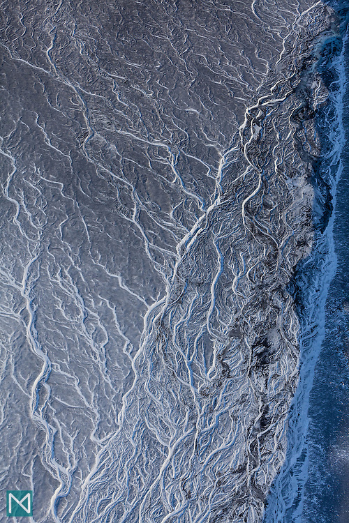 Glacial meltwater carves ribbon-like shapes into the land near Þórisjökull glacier in the Icelandic highland