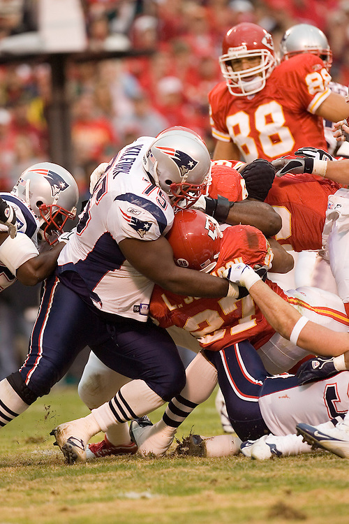 New England Patriot defensive lineman Vince Wilfork wraps up Kansas City Chiefs running back Larry Johnson during a 26 to 16 loss to the Kansas City Chiefs on November 27, 2005 at Arrowhead Stadium in Kansas City, Missouri.
