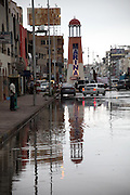 """09.MARCH.2014. HURGHADA<br /> <br /> CODE - JEZ<br /> <br /> RESIDENTS AND BUSINESSES WERE TAKEN UNAWARES TODAY WHEN A STORM HIT THE RESORT CITY OF HURGHADA ON THE RED SEA, EGYPT.  RAIN OF SUCH MAGNITUDE HAD NOT BEEN SEEN THERE FOR MANY, MANY YEARS, """"FOURTEEN YEARS"""" SAID MOST, WITH A FEW OTHERS BELIEVING THAT THEY HADN'T SEEN ANYTHING LIKE IT IN TWENTY YEARS. ROAD CLOSURES, HOUSES AND SHOPS WERE FLOODED.<br /> <br /> THE RESIDENTS DID ALL THEY COULD, WITH MAKESHIFT SAND BAGS AND BALING OUT AS MUCH WATER AS THEY COULD WITH ANY RECEPTACLES THEY COULD LAY THEIR HANDS ON.<br /> <br /> HURGHADA IS NOT KNOWN FOR HAVING AN ARRAY OF UMBRELLA AND WELLINGTON BOOT STORES!<br /> <br /> BYLINE: EDBIMAGEARCHIVE.CO.UK<br /> <br /> *THIS IMAGE IS STRICTLY FOR UK NEWSPAPERS AND MAGAZINES ONLY*<br /> *FOR WORLD WIDE SALES AND WEB USE PLEASE CONTACT EDBIMAGEARCHIVE - 0208 954 5968*"""