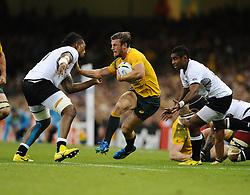 Fiji replacement Nemia Soqeta tackles Australia Winger Rob Horne  - Mandatory byline: Joe Meredith/JMP - 07966386802 - 23/09/2015 - Rugby Union, World Cup - Millenium Stadium -Cardiff,Wales - Australia v Fiji - Rugby World Cup 2015 - Pool A