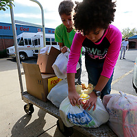 Thomas Wells | BUY AT PHOTOS.DJOURNAL.COM<br /> Daniel Pearson, 10, left, and his friend, Kendal Pugh, 9, begin to load a cart with over 100 cans of food that Pearson collected through his classroom for the Salvation Army.