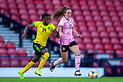 Lisa Evans (#11) of Scotland dribbles with the ball under pressure from Den-Den Blackwood (#14) of Jamaica during the International Friendly match between Scotland Women and Jamaica Women at Hampden Park, Glasgow, United Kingdom on 28 May 2019.