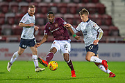 Arnaud Djoum (#10) of Heart of Midlothian passes the ball past Andrew Nelson (#21) of Dundee FC during the Ladbrokes Scottish Premiership match between Heart of Midlothian and Dundee at Tynecastle Stadium, Edinburgh, Scotland on 23 January 2019.