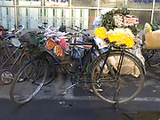 bicycle packed with flowers waiting outside a flower market China Beijing