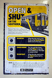 © Licensed to London News Pictures. 03/12/2011, London, UK. A poster informing passengers how to operate the new electronic door open and close buttons on trains. Staff working at Richmond Station in London have uncovered railway posters from the late 1980's whilst upgrading poster holders. Photo credit : Stephen Simpson/LNP