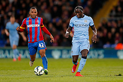 Bacary Sagna of Manchester City is challenged by Jason Puncheon of Crystal Palace - Photo mandatory by-line: Rogan Thomson/JMP - 07966 386802 - 06/04/2015 - SPORT - FOOTBALL - London, England - Selhurst Park - Crystal Palace v Manchester City - Barclays Premier League.