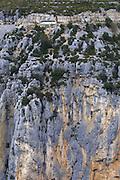 Canyon du Verdon. A tourist bus is dwarfed by the steep cliffs.