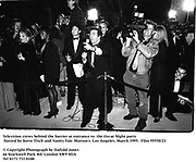 Press behind the barier at entrance to d the Oscar Night party hosted by Steve Tisch and Vanity Fair. Morton's. Los Angeles. March 1995. 95550/23<br /> © Copyright Photograph by Dafydd Jones<br /> 66 Stockwell Park Rd. London SW9 0DA<br /> Tel 0171 733 0108