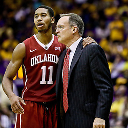 Jan 30, 2016; Baton Rouge, LA, USA; Oklahoma Sooners guard Isaiah Cousins (11) hugs head coach Lon Kruger during the second half of a game against the LSU Tigers at the Pete Maravich Assembly Center. Oklahoma defeated LSU 77-75. Mandatory Credit: Derick E. Hingle-USA TODAY Sports