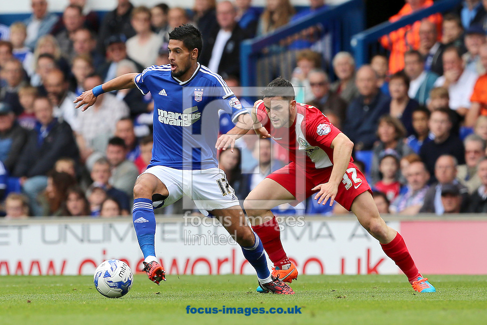Kevin Bru of Ipswich Town shields the ball from Craig Conway of Blackburn Rovers during the Sky Bet Championship match at Portman Road, Ipswich<br /> Picture by Richard Calver/Focus Images Ltd +447792 981244<br /> 18/10/2014