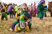 Costumed revelers during the Mamou Courir de Mardi Gras chicken run on Fat Tuesday February 17, 2015 in Mamou, Louisiana. The traditional Cajun Mardi Gras involves costumed revelers competing to catch a live chicken as they move from house to house throughout the rural community.