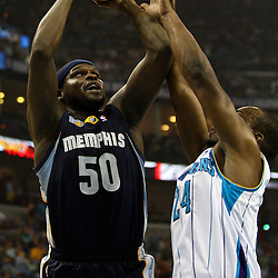 April 1, 2011; New Orleans, LA, USA; Memphis Grizzlies power forward Zach Randolph (50) shoots over New Orleans Hornets power forward Carl Landry (24) during the first quarter at the New Orleans Arena.    Mandatory Credit: Derick E. Hingle
