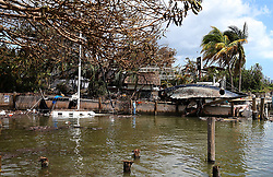 A sunken sail boat and the hull of a destroyed sail boat are seen on the seawall at Scottish Landing waterfront dining restaurant at Grove Key Marina in Miami, after Hurricane Irma passed over South Florida, on Tuesday, September 12, 2017. Photo by Pedro Portal/El Nuevo Herald/TNS/ABACAPRESS.COM