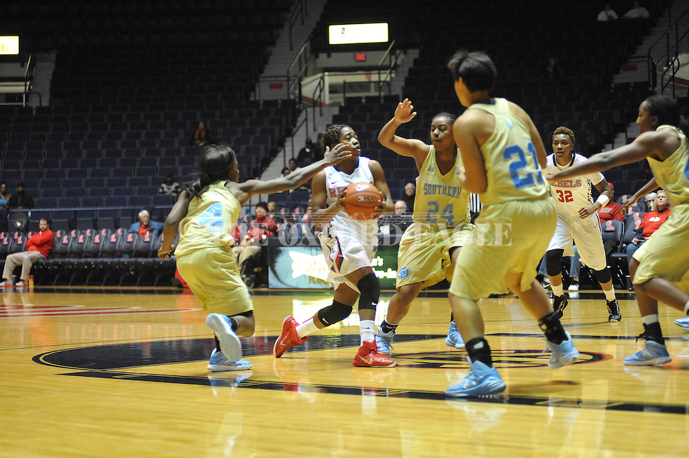 "Ole Miss guard Erika Sisk (5) vs. Southern University Jaguars guard Micah Garvin (24) at the C.M. ""Tad"" Smith Coliseum in Oxford, Miss. on Thursday, November 20, 2014. (AP Photo/Oxford Eagle, Bruce Newman)"