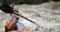 Chris Pelzer of Tipton, Ia. races in the K1 Men's Expert class on the slalom course of the 45th Annual Missouri Whitewater Championships. Pelzer placed fifth in the class and also placed first in the K1 Men's Long Plastic (under 30) class. The Missouri Whitewater Championships, held on the St. Francis River at the Millstream Gardens Conservation Area, is the oldest regional whitewater slalom race in the United States. Heavy rain in the days prior to the competition sent water levels on the St. Francis River to some of the highest heights that the race has ever been run. Only expert classes were run on the flood level race course.