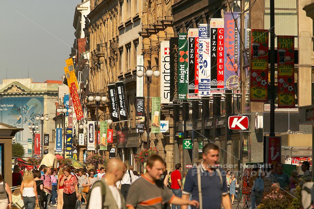 Czeck Republic, Prague, Shop banners line the buildings along busy Wenceslas Square