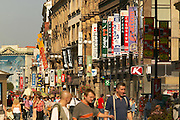 Czeck Republic, Prague, Shop banners line the buildings along busy Wenceslas Square