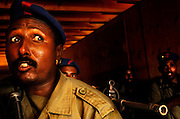 Policeman, Bachir Abdillah Nour, watches as his teammates move forward in the hallway on Nov. 16, 2005. Djiboutian police train in counter terrorism messures with the US Marine Corps off the Horn of Africa.