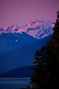 Snowcapped mountains with the pink hue of a winter sunset near Wrangell, Alaska, February 5, 2017. <br /> Photo by David Lienemann