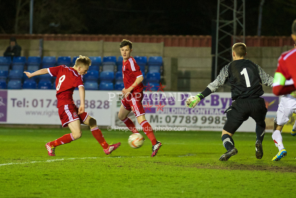 RHYL, WALES - Tuesday, March 18, 2014: Wales' Matty Smith scores the first goal against Poland during the Under-15's International Friendly match at Belle Vue. (Pic by David Rawcliffe/Propaganda)