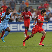 Fernando, (left), Manchester City, chases Philippe Coutinho, Liverpool, during the Manchester City Vs Liverpool FC Guinness International Champions Cup match at Yankee Stadium, The Bronx, New York, USA. 30th July 2014. Photo Tim Clayton