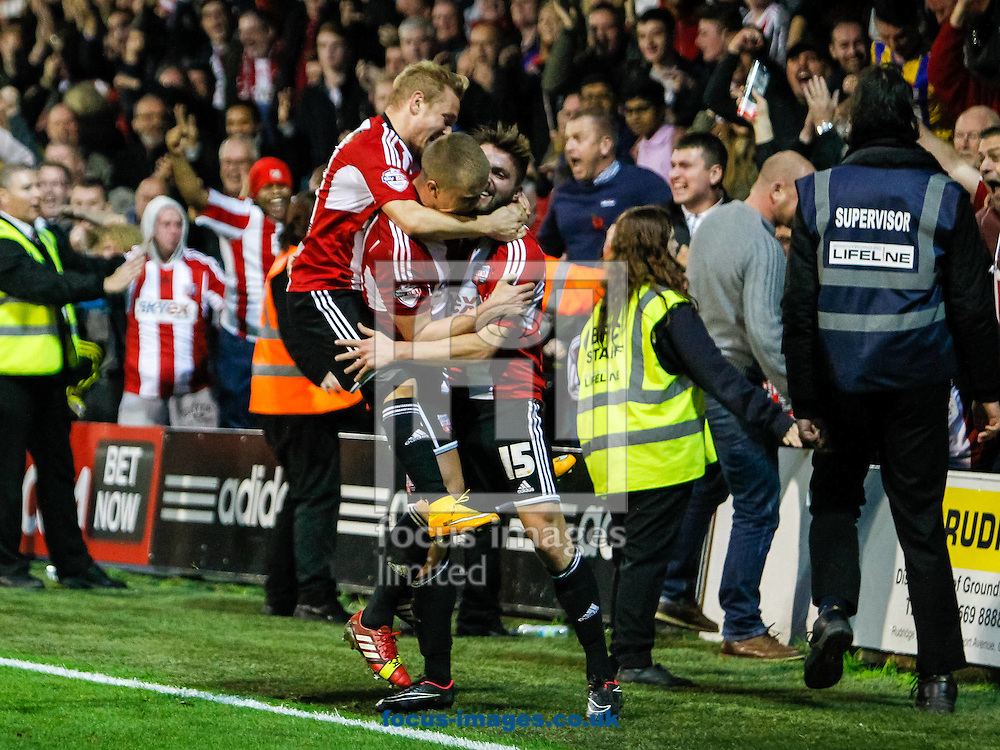 Stuart Dallas of Brentford celebrates scoring the winner with his team mates during the Sky Bet Championship match between Brentford and Derby County at Griffin Park, London<br /> Picture by Mark D Fuller/Focus Images Ltd +44 7774 216216<br /> 01/11/2014