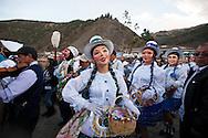 """Feast of """"Mamacha del Carmen"""" of Paucartambo. The """"Panaderas"""" dancing across the bridge Carlos tercero"""