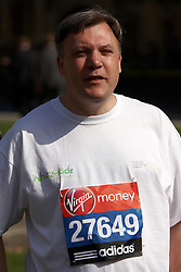 © Licensed to London News Pictures.  29/03/2012. LONDON, UK. Shadow Chancellor Ed Balls (pictured) poses in his running gear (including compression tights) with  fellow Virgin London Marathon runners from his two chosen charities, Whizz-Kidz and Action for Stammering Children. Photo credit:  Cliff Hide/LNP
