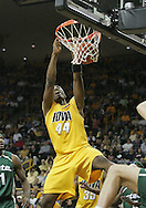 04 JANUARY 2007: Iowa forward Cyrus Tate (44) dunks the ball past Michigan State center Goran Suton (14) in Iowa's 62-60 win over Michigan State at Carver-Hawkeye Arena in Iowa City, Iowa on January 4, 2007.