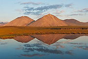 Peaks in the Brooks Range reflect in a small pond near the Canning River in the Arctic National Wildlife Refuge. Alaska