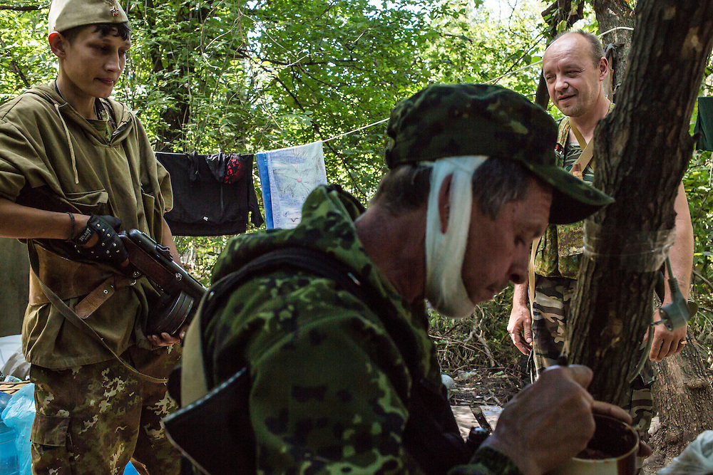 Pro-Russia rebels at a camp by a checkpoint on the outskirts of the city on Monday, July 28, 2014 in Horlivka, Ukraine.