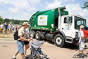 Recycling truck compacting milk carton boats as they come from Lake Calhoun. Aquatennial Beach Bash Minneapolis Minnesota USA