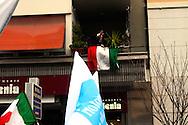Roma 20  Marzo 2010.Manifestazione nazionale  del Pdl a sostegno dei candidati del centrodestra alle prossime Regionali. Una signora  saluta il corteo con il saluto fascista i n via Appia.Rome March 20, 2010.The PDL national demonstration in support of the center-right candidate in the forthcoming Regional.