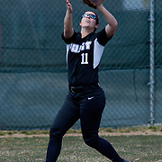 Post University infielder Lianna May (11) makes a catch in (left) field in the fifth inning of game #1 of NCAA Central Atlantic Collegiate Conference (doubleheader) against Goldey-Beacom Saturday, March 30, 2013, at Nancy Churchmann Sawin Athletic Field in Wilmington Delaware.