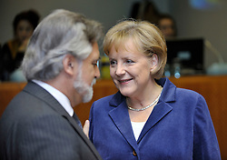 Angela Merkel, Germany's chancellor, speaks with Luis Amado, Portugal's foreign minister, during the European Union Summit at the EU headquarters in Brussels, Belgium, on Thursday, Oct. 29, 2009.