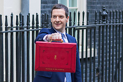 Downing Street, London, March 16th 2016. The Chancellor of The Exchequer George Osborne appears outside 11 Downing Street with his famous red dispatch box and his team prior to taking the short journey to Parliament to deliver his 2016 budget. ©Paul Davey<br /> FOR LICENCING CONTACT: Paul Davey +44 (0) 7966 016 296 paul@pauldaveycreative.co.uk