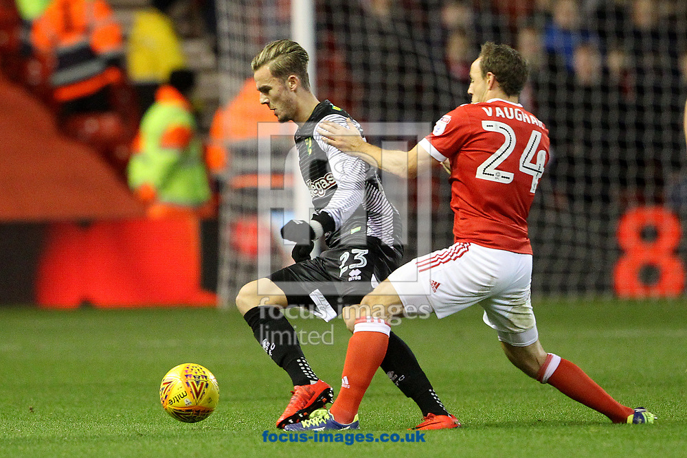 James Maddison of Norwich and David Vaughan of Nottingham Forest in action during the Sky Bet Championship match at the City Ground, Nottingham<br /> Picture by Paul Chesterton/Focus Images Ltd +44 7904 640267<br /> 21/11/2017