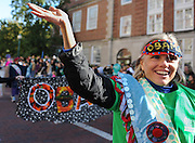 Janalee Stock, an Athens City School Nurse, dons pro Obama garb in the Ohio University Homecoming Parade in Athens, Ohio, Oct. 13, 2012.