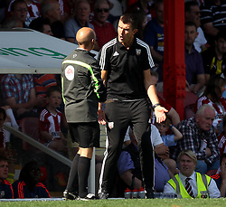 Brentford Head Coach, Marinus Dijkhuizen complains to fourth official Nicholas Kinseley - Mandatory by-line: Robbie Stephenson/JMP - 07966386802 - 08/08/2015 - SPORT - FOOTBALL - Brentford,England - Griffin Park - Brentford v Ipswich Town - Sky-Bet Championship