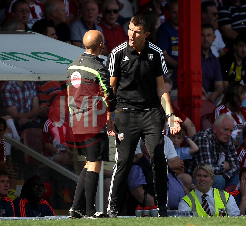 Brentford Head Coach, Marinus Dijkhuizen complains to fourth official Nicholas Kinseley - Mandatory by-line: Robbie Stephenson/JMP - 07966386802 - 08/08/2015 - SPORT - FOOTBALL - Brentford,England - Griffin Park - Brentford v Ipswich Town - Sky-Bet Championship