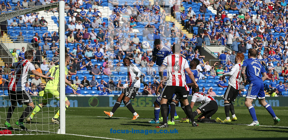 Sean Morrison scores the equaliser for Cardiff City against Brentford during the Sky Bet Championship match at the Cardiff City Stadium, Cardiff<br /> Picture by Mike Griffiths/Focus Images Ltd +44 7766 223933<br /> 08/04/2017