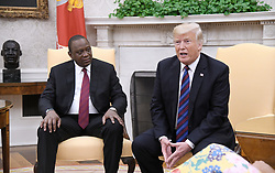 U.S. President Donald Trump speaks as Kenya's President Uhuru Kenyatta looks on during a bilateral meeting in the Oval Office of the White House August 27, 2018 in Washington, DC. . Photo by Olivier Douliery/ Abaca Press