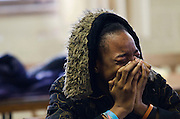 Lauren Justice | MLive.com<br /> <br /> Shaterria Brown, sister of Shukur Brown, 16, cries during a press conference Thursday, January 3. Shukur Brown and his family have come forward in a press conference to discuss the need to put weapons down and that gun violence needs to cease Thursday, January 3. Shukur Brown has turned himself in to Flint police in connection to what he says was an accidental shooting of Jianni Harron, 15, on New Year's Day.