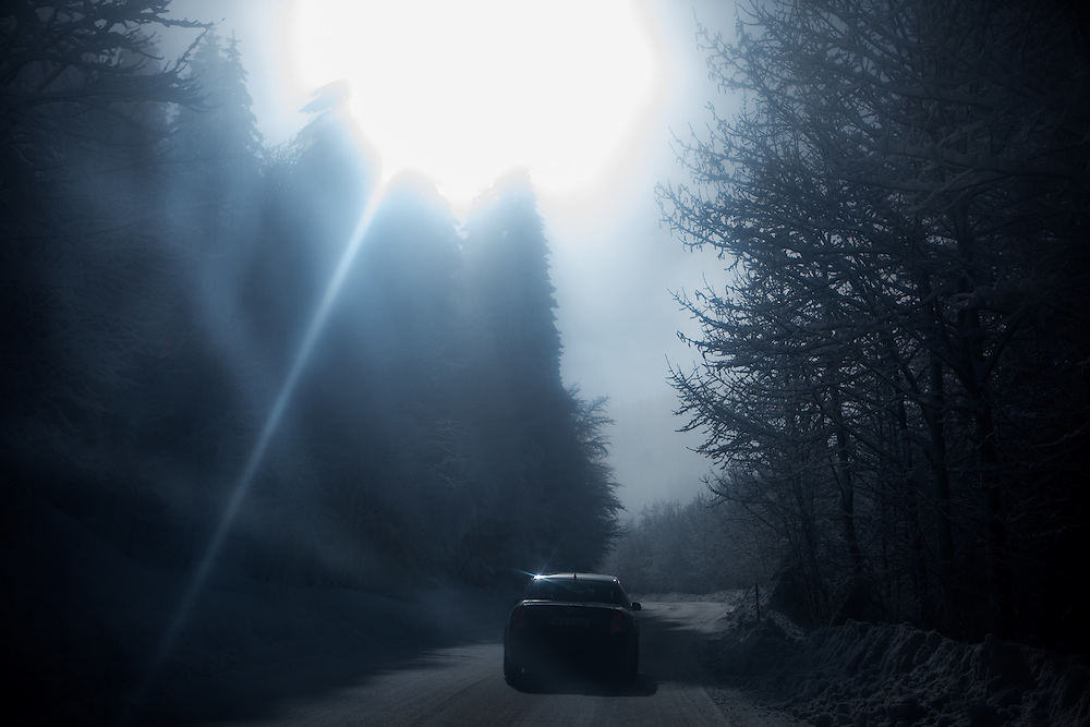 A car on the winter road leading from the city of Hadžići up to Igman which is a mountain plateau in central Bosnia and Herzegovina. During the 1984 Winter Olympics, Igman was, along with Jahorina and Bjelašnica, the location of the competition in the alpine and Nordic sports disciplines. The family of Elvis settled in Hadžići  after the war ended in Bosnia. Hadžići is a town and a municipality located about 20 km south west of Sarajevo city but within the Sarajevo Canton of Bosnia and Herzegovina. According to the census of 2013, Hadžići municipality has a population of 23,891 residents.