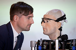 © Licensed to London News Pictures. 05/02/2013. London, UK. Television presenter and prosthetic user Bertolt Meyer looks into the eyes of a bionic man made completely from replacement body parts, including a face modelled on Meyer's, at the Science Museum in London today (05/02/13). The artificial man, made up of different costing around US$1,000,000, stands at . Photo credit: Matt Cetti-Roberts/LNP