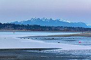 The Golden Ears (Mount Blandshard) and Mud Bay (Boundary Bay) after sunset.  Photographed from Blackie Spit at Crescent Beach, Surrey, British Columbia, Canada